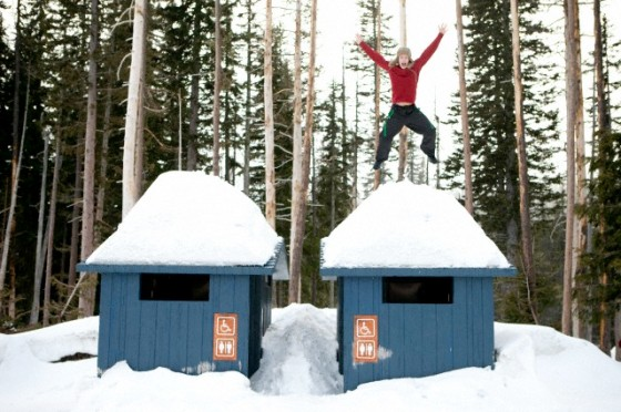 Man jumping off snow-covered roof
